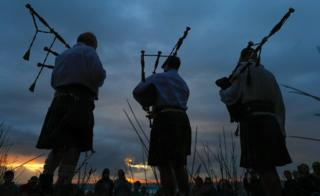 Men playing bag-pipes at sunset, Cape Town, South Africa - Sunday 31 December 2017