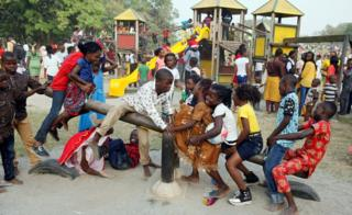 Children playing on the seesaw at the Millennium park in Abuja, Nigeria - Monday 1 January 2018