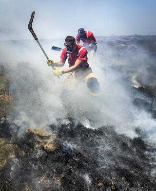 Fire chiefs declared a major incident on Saturday after two large-scale blazes either side of Winter Hill near Bolton merged because of increased wind speed. Tuesday July 3, 2018.
