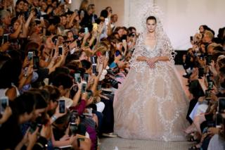 A model presents a wedding dress by designer Elie Saab as part of his Haute Couture Fall/Winter 2018/2019 fashion show in Paris, France, July 4, 2018