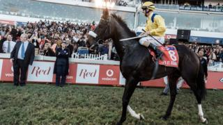 Jockey Anton Marcus rides Do it Again after winning the Vodacom Durban July horse race in Durban, on July 7, 2018